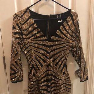 Shiny black and gold mini dress